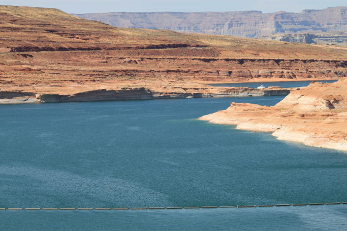 This Aug. 21, 2019 image shows Lake Powell near Page, Arizona. A plan by Utah could open the door to the state pursuing an expensive pipeline that critics say could further deplete the lake, which is a key indicator of the Colorado River's health. (AP Photo/Susan Montoya Bryan)