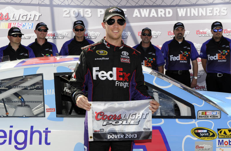 Denny Hamlin poses with his award after he won the pole during NASCAR Sprint Cup Series auto race qualifying on Friday, May 31, 2013, at Dover International Speedway in Dover, Del. (AP Photo/Nick Wass)