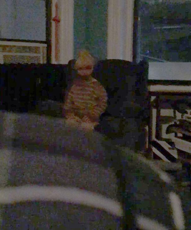 Adam Ellis claims he saw this ghost sitting on his apartment couch. Photo: Twitter/Adam Ellis