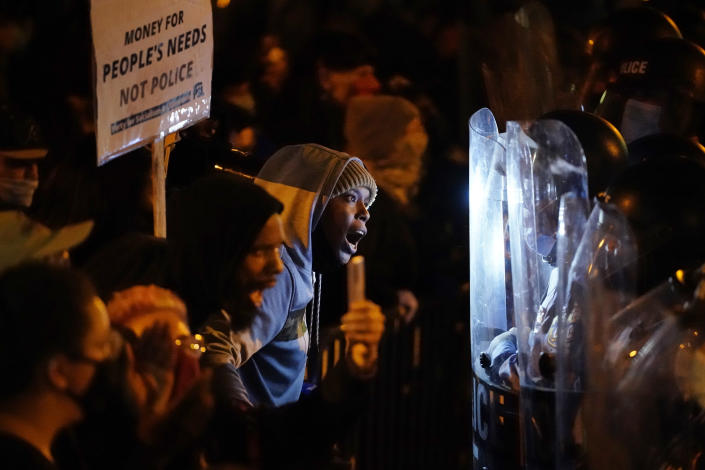 Protesters confront police during a march Tuesday Oct. 27, 2020 in Philadelphia. Hundreds of demonstrators marched in West Philadelphia over the death of Walter Wallace, a Black man who was killed by police in Philadelphia on Monday. Police shot and killed the 27-year-old on a Philadelphia street after yelling at him to drop his knife. (AP Photo/Matt Slocum)