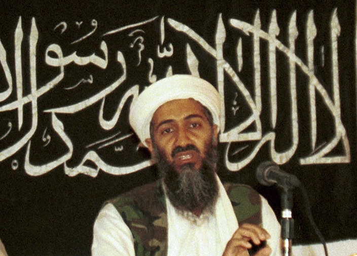 """FILE - In this 1998 file photo made available on March 19, 2004, Osama bin Laden is seen at a news conference in Khost, Afghanistan. After 20 years America is ending its """"forever"""" war in Afghanistan. After the terror assault of 9/11 the world rallied behind America and together the US and NATO entered Afghanistan to hunt down and destroy the mastermind Osama bin Laden and his al Qaida terrorist network. But the US and its allies have been dragged into a war between a re-emergent Taliban and an Afghan government, dominated by warlords, whose power and wealth were alienating ordinary Afghans. (AP Photo/Mazhar Ali Khan, File)"""