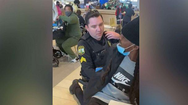 PHOTO: Jamar Mackey is put in handcuffs while eating with his fiancee and their 13-year-old son in the food court at a shopping mall in Virginia Beach, Va., Dec. 19, 2020, after he was mistaken for a suspect in a credit card theft. (Shantel Covil/Facebook)