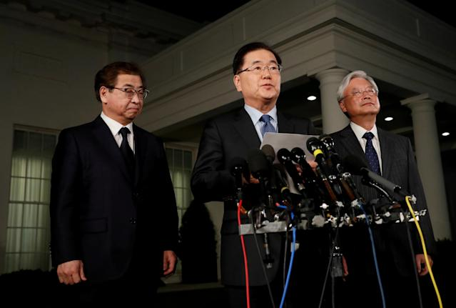 South Korea's national security adviser, Chung Eui-Yong, center, said Thursday that the North Korean leader Kim Jong Un had extended an invitation to meet with U.S. President Donald Trump.