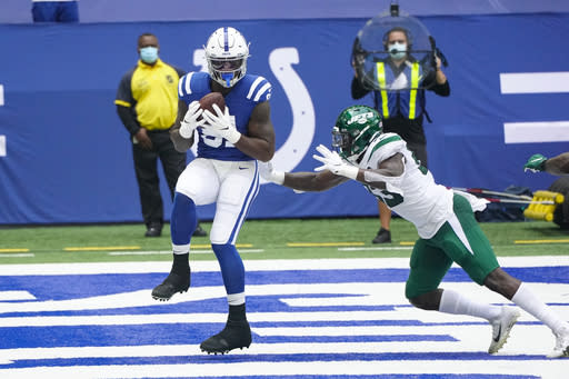 Indianapolis Colts tight end Mo Alie-Cox (81) catches a pass for a touchdown in front of New York Jets outside linebacker Tarell Basham (93) in the first half of an NFL football game in Indianapolis, Sunday, Sept. 27, 2020. (AP Photo/AJ Mast)