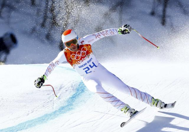 Bode Miller of the U.S. competes in the downhill run of the men's alpine skiing super combined event at the 2014 Sochi Winter Olympics, February 14, 2014. REUTERS/Ruben Sprich (RUSSIA - Tags: OLYMPICS SPORT SKIING)