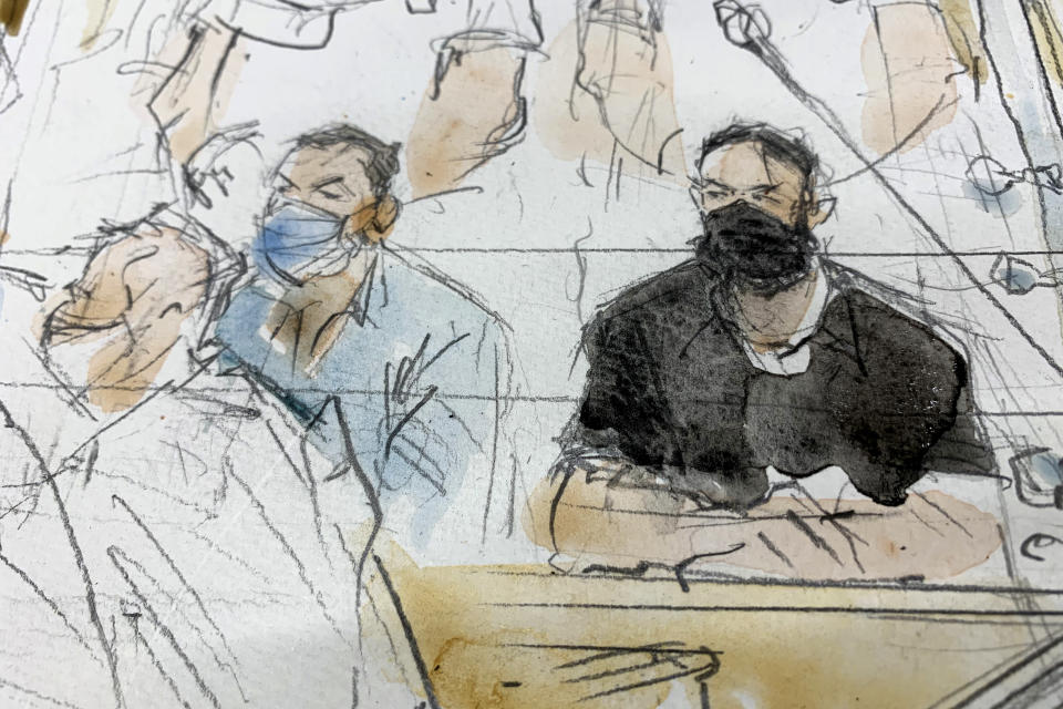 """FILE - Sept.8, 2021 file sketch shows key defendant Salah Abdeslam, right, and Mohammed Abrini in the special courtroom built for the 2015 attacks trial. The key defendant in the 2015 Paris attacks trial said Wednesday that the Islamic State network which struck the city was attacking France, and that the deaths of 130 people was """"nothing personal."""" Wearing all black and declining to remove his black mask, Salah Abdeslam was the last of the 14 defendants present in the custom-built courtroom to speak. (Noelle Herrenschmidt via AP, File)"""