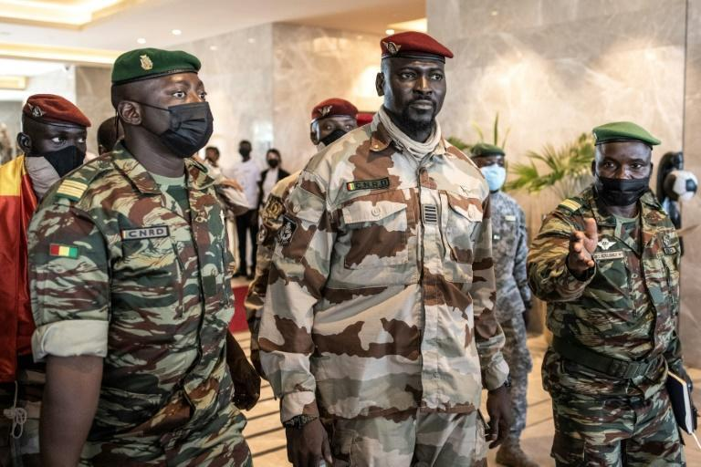 Colonel Mamady Doumbouya, centre, led the coup against President Alpha Conde (AFP/JOHN WESSELS)