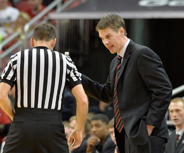Missouri State's head coach Paul Lusk, right, argues a call during the first half of an NCAA college basketball game Tuesday, Dec. 17, 2013, in Louisville, Ky. (AP Photo/Timothy D. Easley)