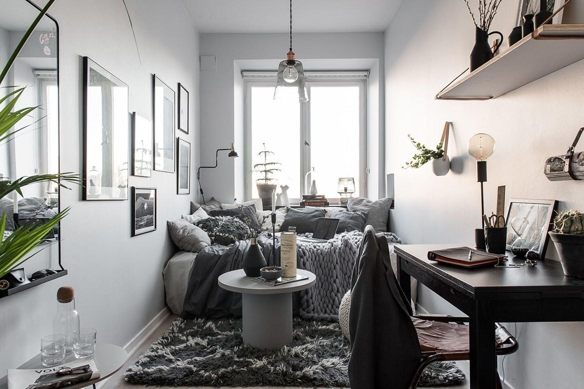 """<div class=""""caption""""> See that mirror in the left corner of the photo? Along the bottom is a cute little shelf, just wide enough for keys, sunglasses, and your wallet. It's basically a teeny-tiny console table for your bedroom. </div> <cite class=""""credit"""">Photo: Peter Pousard/Courtesy of Lundin Fastighetsbyrå</cite>"""