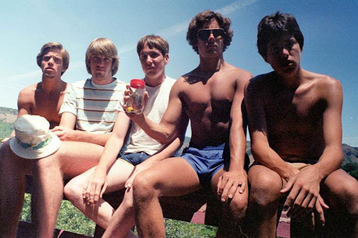 1982: Like all good friendships, there's a photo that takes five high school buddies – John Wardlaw, Mark Rumer, Dallas Burney, John Molony, and John Dickson – back to a different time. For these five, it was just a year after their graduation from high school. They were 19 and vacationing at Copco Lake in northern California. The photo, taken with a self-timer, became was the starting point. (Courtesy of John Wardlaw)