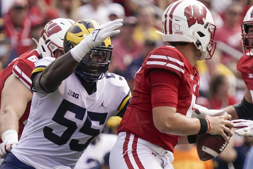 Michigan's David Ojabo sacks Wisconsin's Graham Mertz during the first half of an NCAA college football game Saturday, Oct. 2, 2021, in Madison, Wis. (AP Photo/Morry Gash)