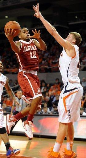 Alabama's Trevor Releford shots around Auburn's Rob Chubb in the first half of an NCAA college basketball game in Auburn, Ala., Tuesday, Feb. 7, 2012. (AP Photo/The Birmingham News, Mark Almond) MAGS OUT
