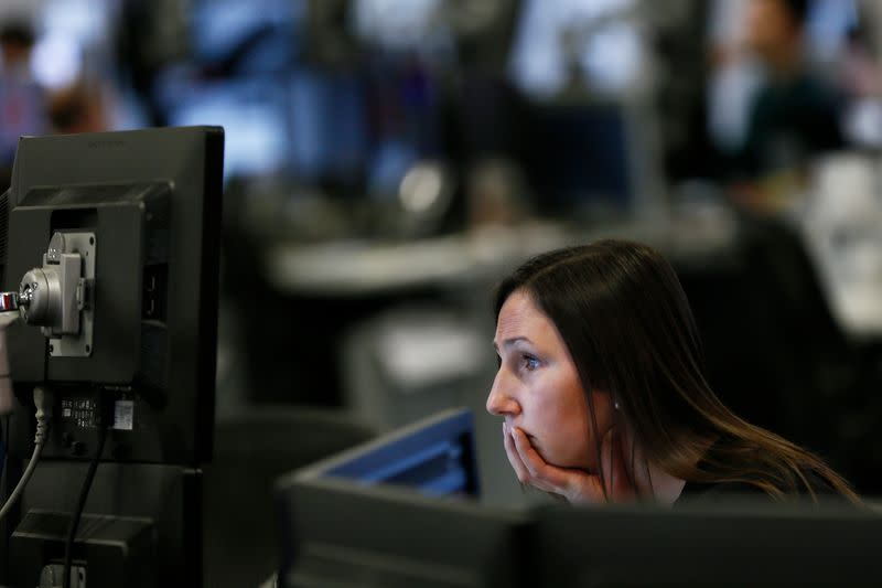 A market maker works on the trading floor at IG Index in London