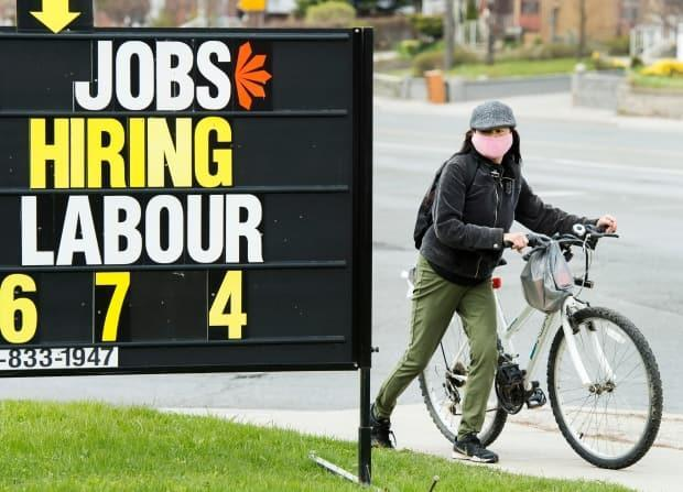 A sign advertising jobs is seen in Toronto.  (Nathan Denette/The Canadian Press - image credit)