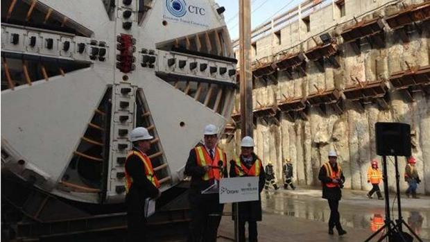 Ontario Transporation Minister Glen Murray speaks in front of a tunnel boring machine for the new Eglinton Crosstown LRT line on Tuesday.