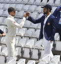 England captain Joe Root, left, and India captain Virat Kohli meet prior to the first Test Match between England and India at Trent Bridge cricket ground in Nottingham, England, Monday, Aug. 2, 2021. (AP Photo/Rui Vieira)