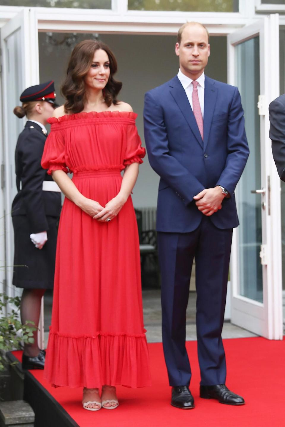<p><b>Kate was a lady in red at a Berlin garden party in an off-the-shoulder, Alexander McQueen dress. <br><em>[Photo: PA]</em> </b></p>