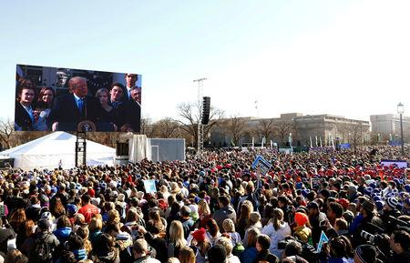 FILE PHOTO: U.S. President Donald Trump, speaking by satellite from the nearby White House, addresses attendees of the March for Life rally in Washington, U.S. January 19, 2018. REUTERS/Eric Thayer/File Photo