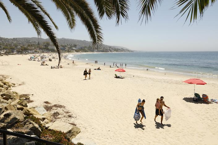 "The city of Laguna Beach has posted signs that read ""You must wear a face covering. It's the law,"" but not everyone is on board. <span class=""copyright"">(Carolyn Cole/Los Angeles Times)</span>"