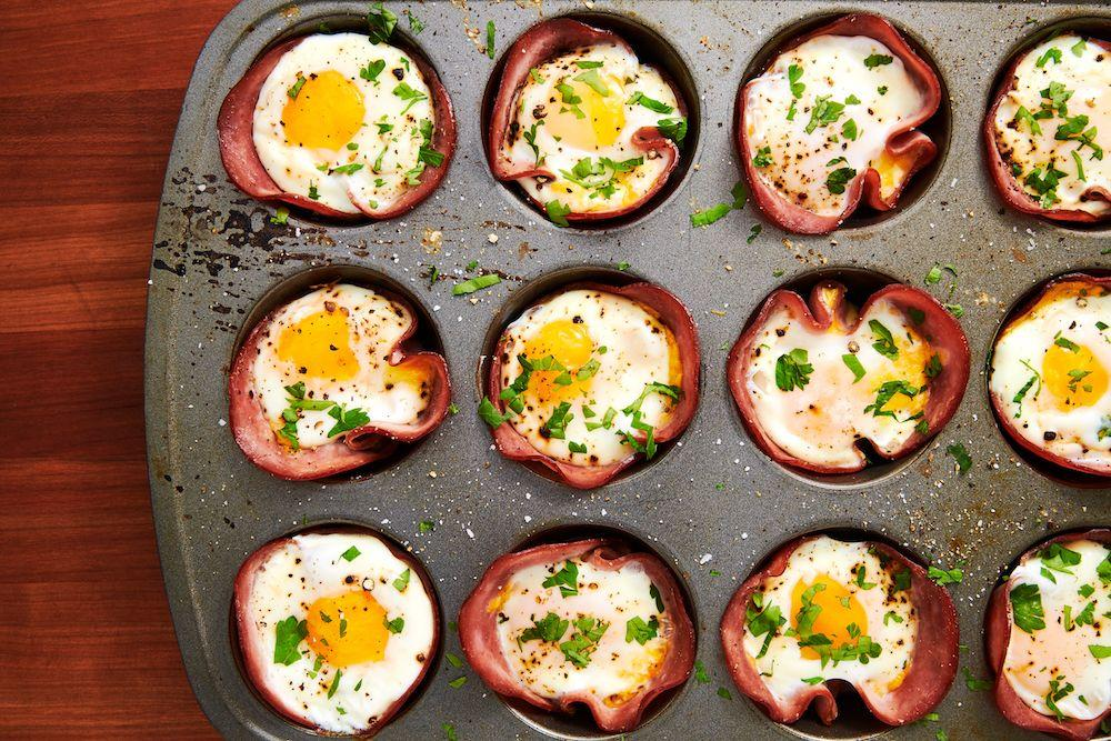 "<p>This low-carb breakfast comes together in no time—seriously, you only need 20-ish minutes! If you like your eggs super runny, you might want to pull them from the oven a minute before you think they're ready. </p><p>Get the <a href=""https://www.delish.com/uk/cooking/recipes/a29030029/ham-cheese-egg-cups-recipe/"" target=""_blank"">Ham And Egg Cups</a> recipe. </p>"