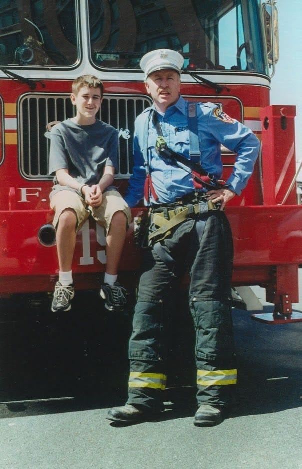 Brian with his father, Joseph Leavey, in front of Ladder 15 at the South Street Seaport in 1999 or 2000.
