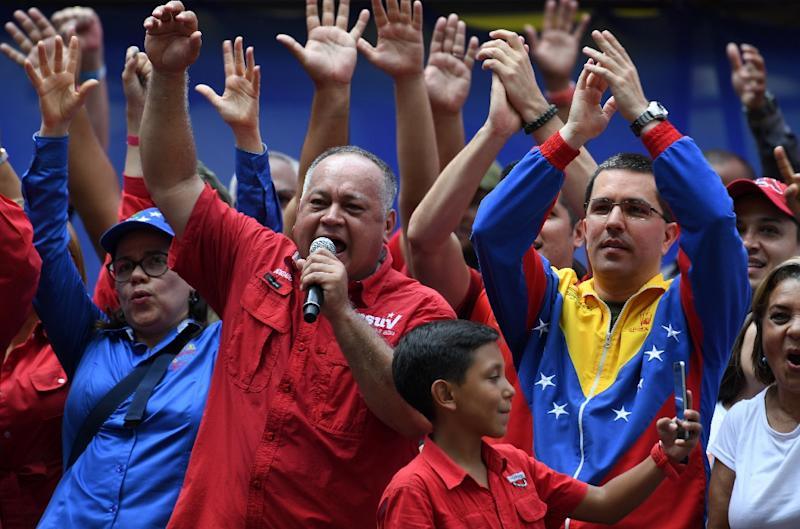 Venezuela National Assembly head Diosdado Cabello (L) won his case against online news website La Patilla (AFP Photo/Yuri CORTEZ)
