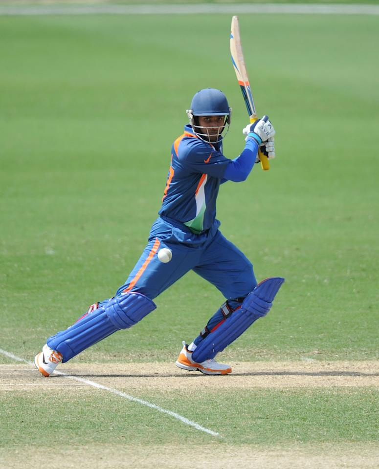 TOWNSVILLE, AUSTRALIA - AUGUST 23:  Hanuma Vihari of India cuts during the ICC U19 Cricket World Cup 2012 Semi Final match between India and New Zealand at Tony Ireland Stadium on August 23, 2012 in Townsville, Australia.  (Photo by Malcolm Fairclough-ICC/Getty Images)