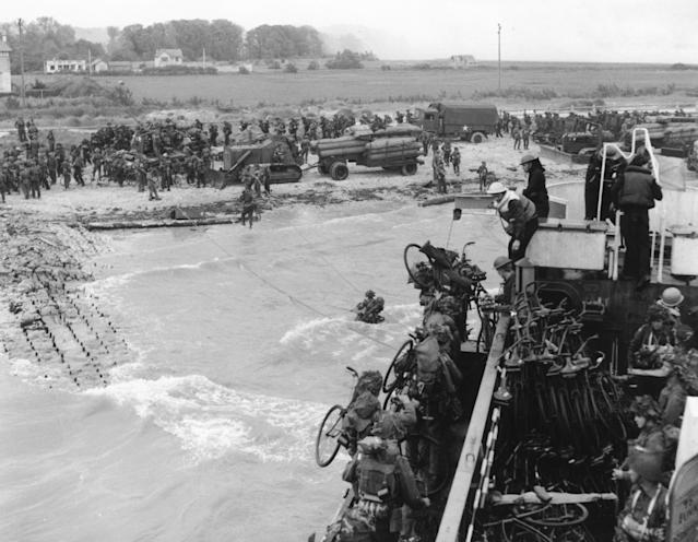 <p>Soldiers of the 2nd Canadian Flotilla are seen as they establish a beachhead code-named Juno Beach, near Bernières-sur-Mer, on the northern coast of France on June 6, 1944, during the Allied invasion of Normandy, France. (Photo: AP) </p>