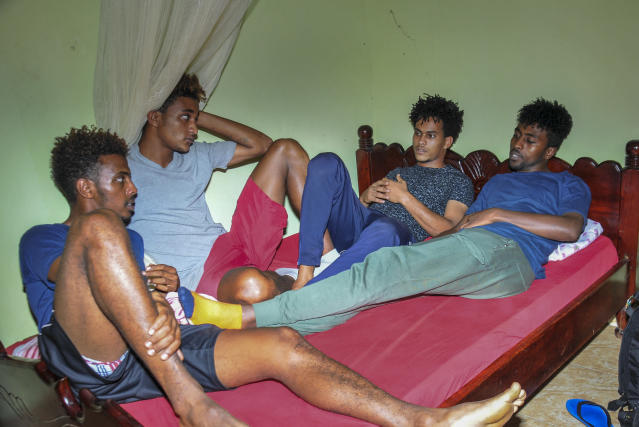 In this photo taken Thursday, Oct. 10, 2019, from left, Eritrean under-20 soccer players Mewael Tesfai Yosief, Simon Asmelash Mekonen, Hanibal Girmay Tekle and Hermon Fessehaye Yohannes talk together in a house where they are staying in Uganda. Four young players with Eritrea's national under-20 soccer team have defected during a tournament in Uganda, the latest players to leave one of the world's most tightly controlled regimes. (AP Photo)