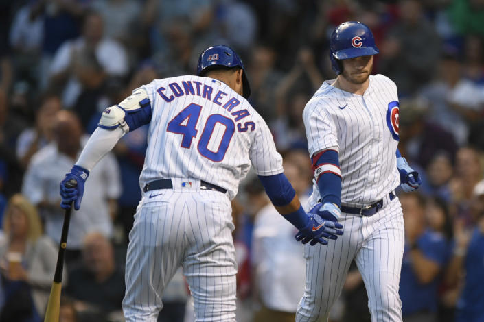 Chicago Cubs' Ian Happ ,right, celebrates with Willson Contreras (40) after hitting a solo home run during the first inning of the tema's baseball game against the Cincinnati Reds on Wednesday, Sept. 8, 2021, in Chicago. (AP Photo/Paul Beaty)
