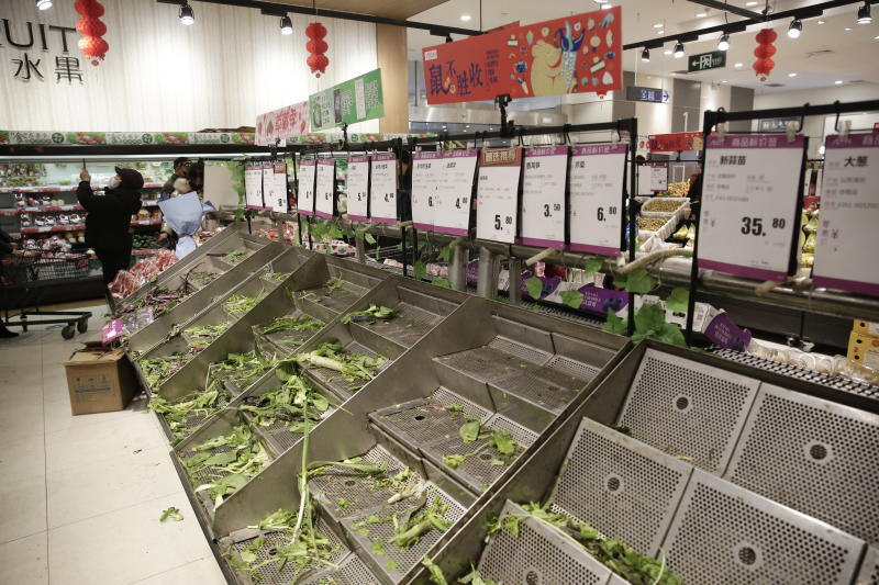Empty vegetable shelves in a Wuhan supermarket that have been stripped bare after the city was placed in lockdown.