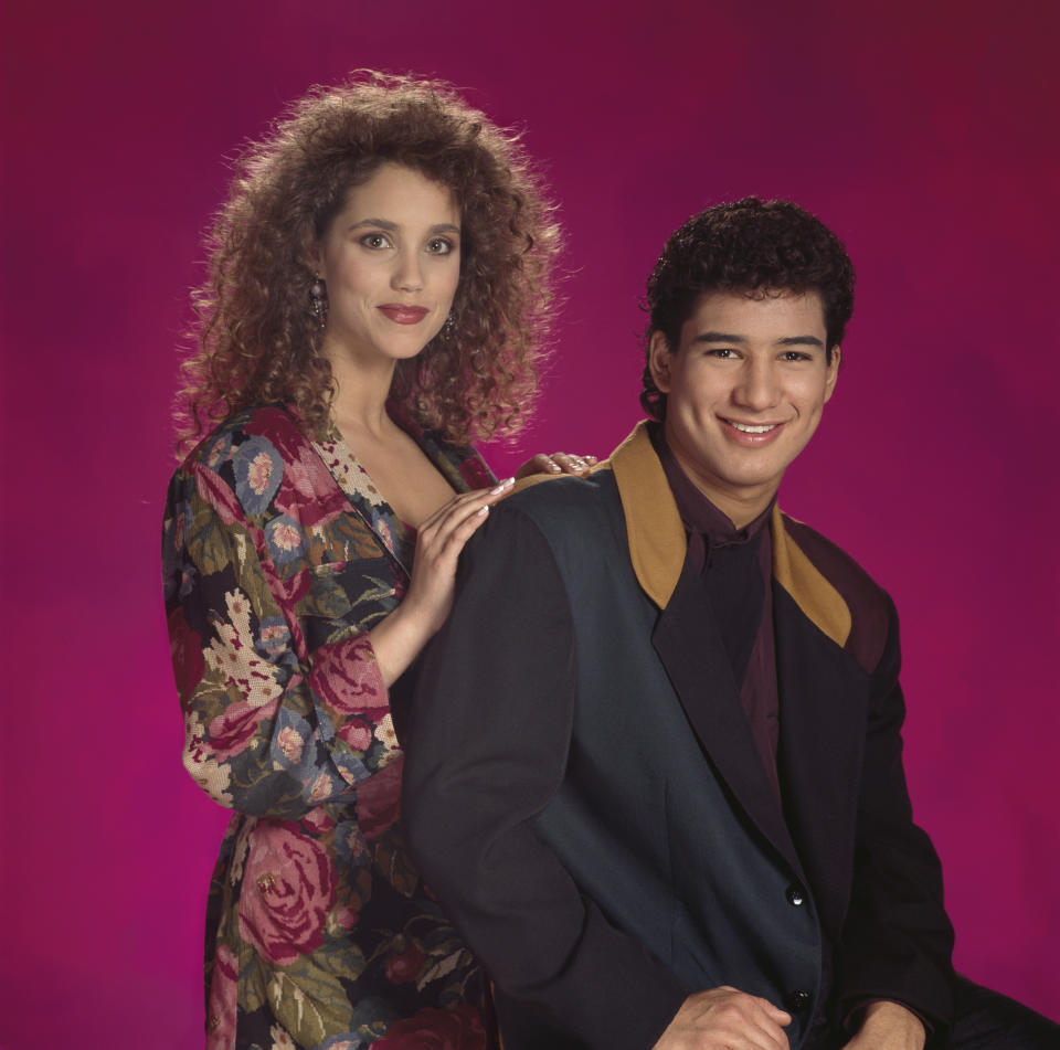 SAVED BY THE BELL -- Pictured: (l-r) Elizabeth Berkley as Jessie Spano, Mario L+?pez as A.C. Slater  (Photo by NBC/NBCU Photo Bank via Getty Images)