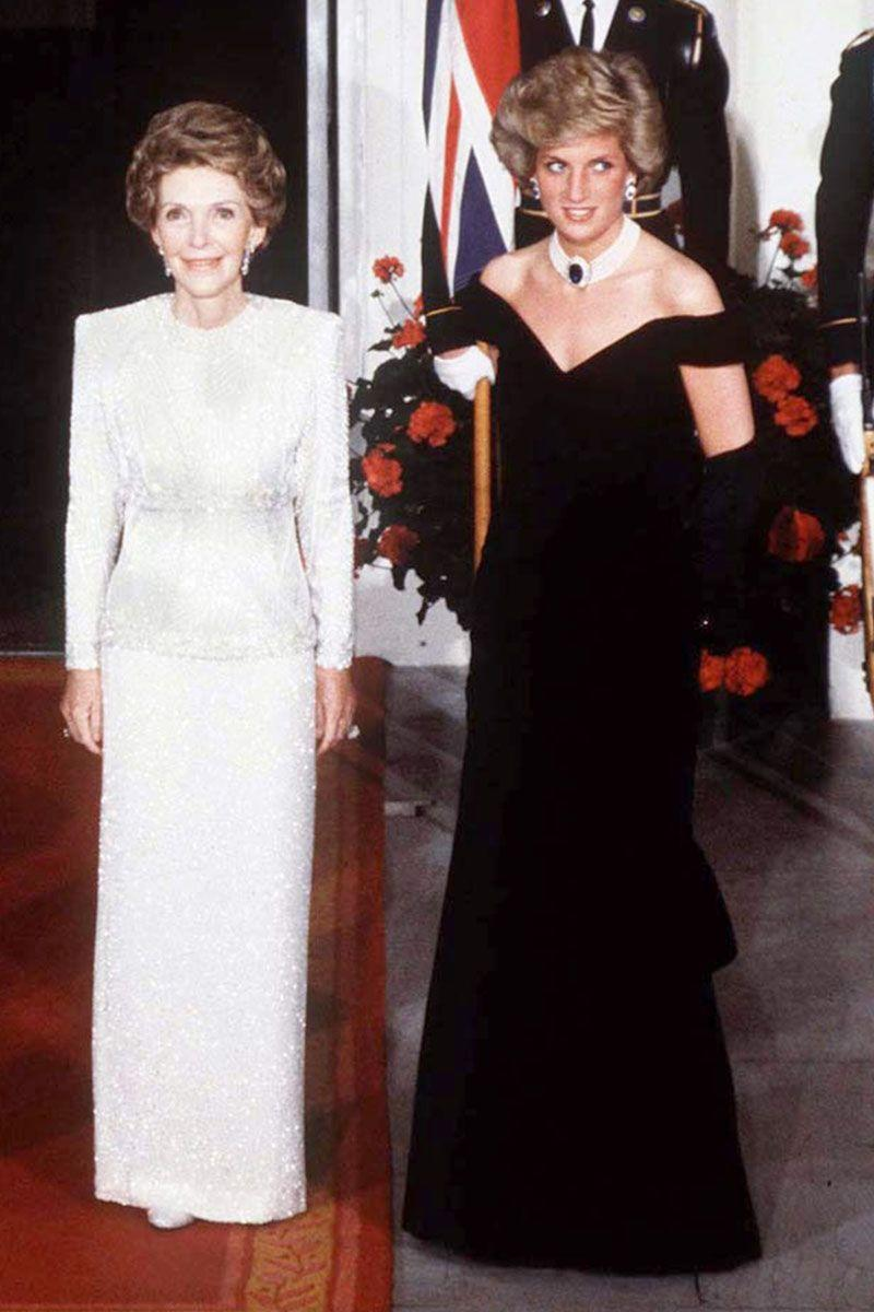 <p>In a black off-the-shoulder gown posing for a picture with Nancy Reagan during an official visit to the United States. </p>