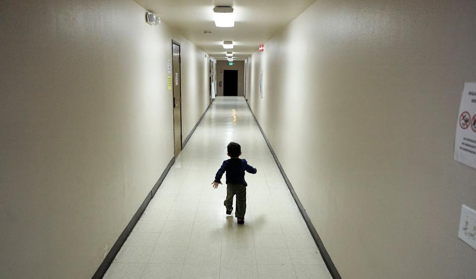 In this 2018 photo, an asylum-seeking boy from Central America runs down a hallway after arriving from an immigration detention center to a shelter in San Diego. The Trump administration separated thousands of migrant children from their families. (Photo: Gregory Bull/Associated Press)