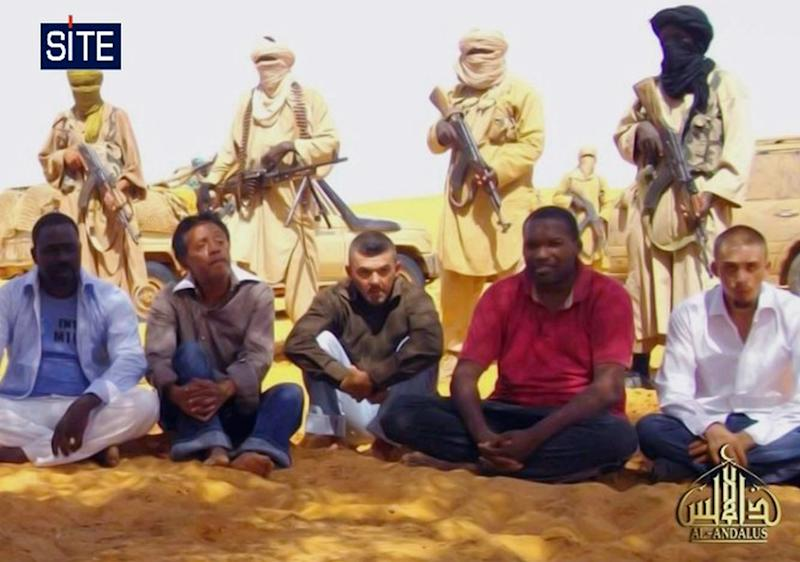 This image taken from video  and provided by U.S.-based SITE Intelligence Group Thursday Sept. 30, 2010 shows the first images of a group of foreign hostages working for a French energy company who were seized in Niger two weeks ago by an al-Qaida offshoot, according to the group that monitors terrorism. The hostages were grabbed in the middle of the night on Sept. 16 from their guarded villas in the uranium mining town of Arlit in Niger where they worked for French nuclear giant Areva. Five are French citizens, the other two are from Togo and Madagascar. (AP Photo/SITE)  **  EDITORIAL USE ONLY  **