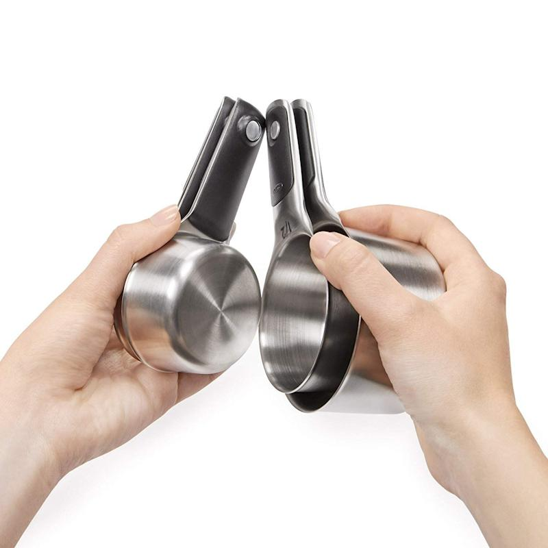 """Keep your measuring cups neatly nestled together with&nbsp;<strong><a href=""""https://amzn.to/2XyVvzG"""" target=""""_blank"""" rel=""""noopener noreferrer"""">the magnetic feature of these</a></strong>. We promise you won&rsquo;t lose your ⅓ cup in the back of the drawer anymore. <strong><a href=""""https://amzn.to/2XyVvzG"""" target=""""_blank"""" rel=""""noopener noreferrer"""">Get them on Amazon</a></strong>."""