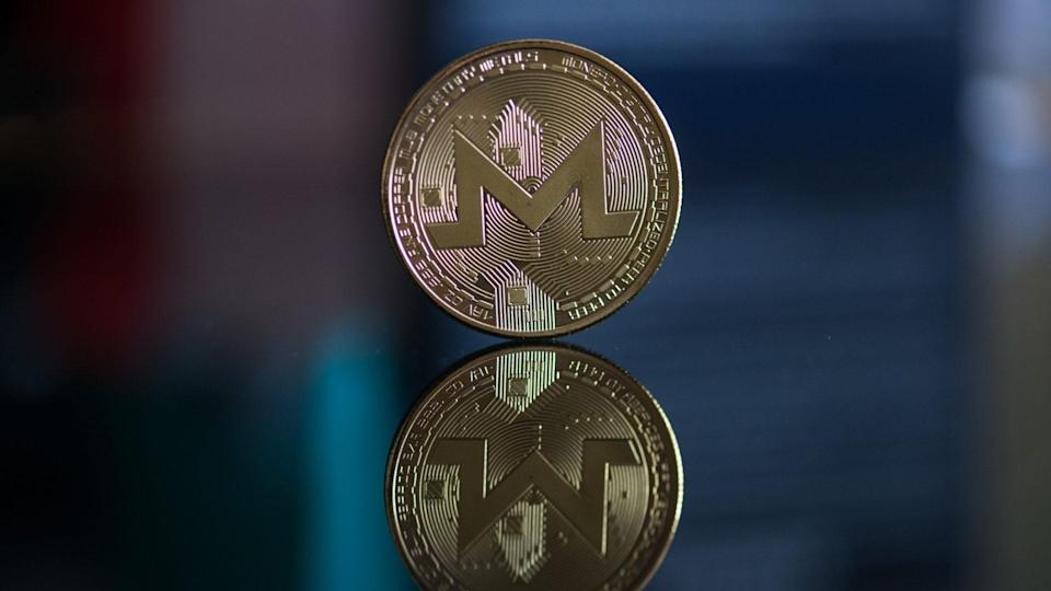 Nitra, Slovakia, march 4, 2018: Monero cryptocurrency coin with reflection.
