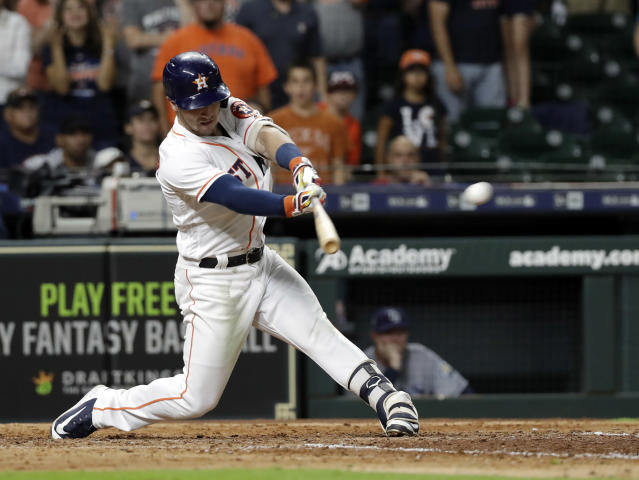 Houston Astros' Alex Bregman hits a game-winning double to score two runs against the Tampa Bay Rays during the ninth inning of a baseball game Monday, June 18, 2018, in Houston. The Astros won 5-4. (AP Photo/David J. Phillip)
