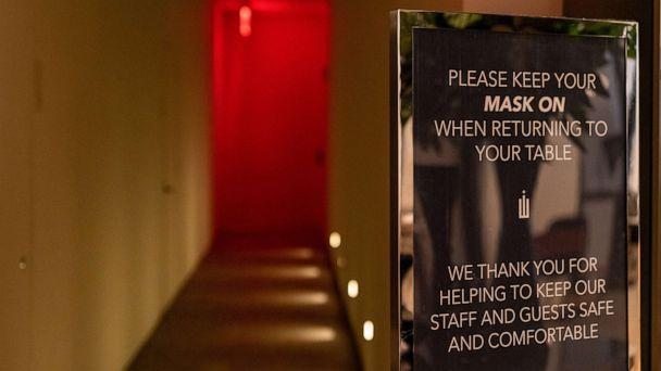 PHOTO: A sign asks customers to keep a mask on while returning to tables at Crown Shy restaurant in New York City, on Sept. 26, 2020. New York City will allowindoor dining rooms at 25% capacity beginningSept. 30. (Bloomberg via Getty Images)