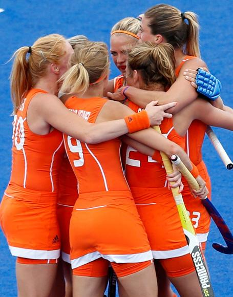Netherlands women's national hockey team celebrate after their team mate Kim Lammers scored a goal against Belgium during their women's Group A hockey match at the London 2012 Olympic Games at the Riverbank Arena on the Olympic Park in London July 29, 2012. REUTERS/Suzanne Plunkett