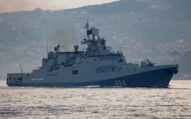 The Grigorovich, a sleek but distinctly Russian looking vessel, in the traditional dark shade of grey of Russian vessels, sails through the Bosphorus - Credit: Yoruk Isik/Reuters