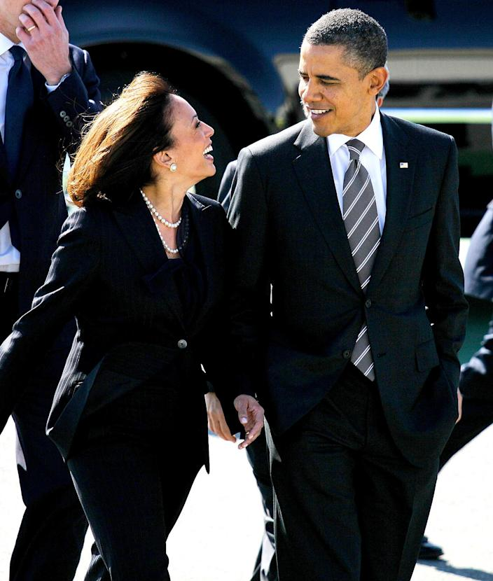 """<p>Harris was an early supporter of President Barack Obama. Here, she is seen greeting him in San Francisco, California in 2012. </p> <p>When Joe Biden <a href=""""https://people.com/politics/barack-obama-says-kamala-harris-is-more-than-prepared/"""" rel=""""nofollow noopener"""" target=""""_blank"""" data-ylk=""""slk:selected Harris as his running mate in 2020,"""" class=""""link rapid-noclick-resp"""">selected Harris as his running mate in 2020,</a> Obama <a href=""""https://twitter.com/BarackObama/status/1293295296819220481/photo/1"""" rel=""""nofollow noopener"""" target=""""_blank"""" data-ylk=""""slk:said in a statement"""" class=""""link rapid-noclick-resp"""">said in a statement</a>, """"I've known Senator Harris for a long time. She is more than prepared for the job. She's spent her career defending our Constitution and fighting for folks who need a fair shake. Her own life story is one that I and so many others can see ourselves in: a story that says that no matter where you come from, what you look like, how you worship, or who you love, there's a place for your here. It's a fundamentally American perspective, one that's led us out of the hardest of times before. And it's a perspective we can all rally behind right now.""""</p>"""