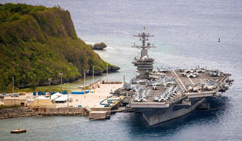 "American aircraft carrier USS Theodore Roosevelt is seen moored at Naval Base Guam in May 2020. The carrier led a strike group on a ""freedom of navigation"" exercise, the first routine operation in the region under new president Joe Biden, on Saturday. Photo: US Navy via AFP"