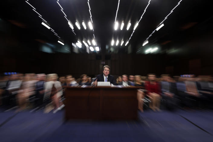 """FILE - In this Thursday, Sept. 6, 2018 file photo made with a slow shutter speed and a zoom lens, President Donald Trump's Supreme Court nominee, Brett Kavanaugh testifies before the Senate Judiciary Committee on Capitol Hill in Washington, for the third day of his confirmation hearing. On Thursday, Sept. 20, 2018, an attorney for Christine Blasey Ford said she would testify to the Senate next week about her accusation that Kavanaugh assaulted her when both were high school students if agreement can be reached to """"terms that are fair and which ensure her safety."""" (AP Photo/Alex Brandon)"""