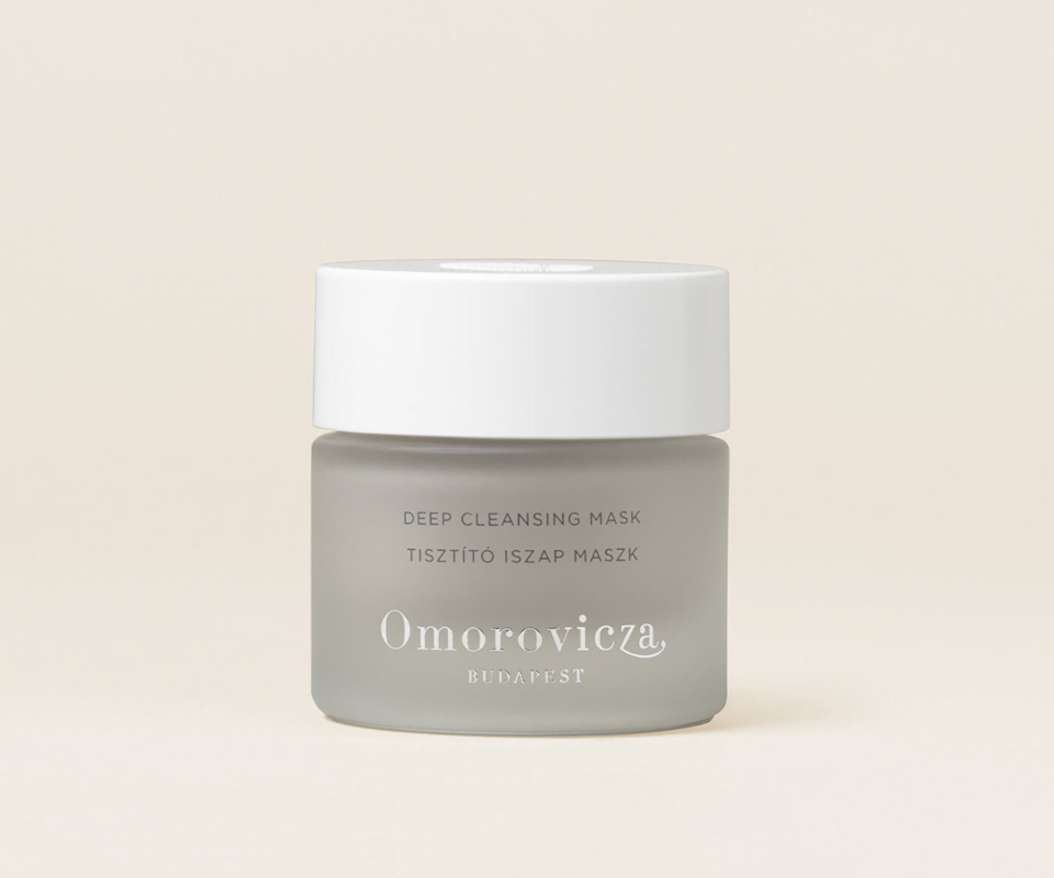 A small grey tub of Omorovicza's deep cleansing mud mask with a white screw lid.