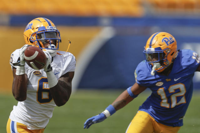 Pittsburgh wide receiver Aaron Mathews (6) makes a catch as defensive back Paris Ford defends during their annual intrasquad Blue-Gold spring NCAA college football game, Saturday, April 13, 2019, in Pittsburgh. (AP Photo/Keith Srakocic)