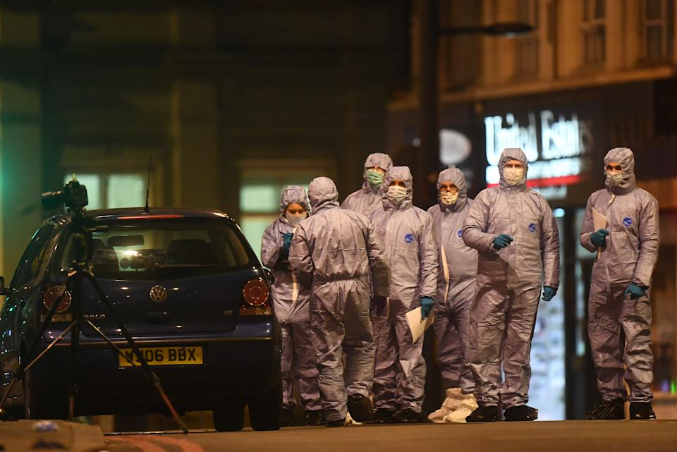 A police forensics officers works at the scene in Streatham High Road, south London after a man was shot dead by armed officers, with police declaring the incident as terrorist-related. (Photo by Victoria Jones/PA Images via Getty Images)