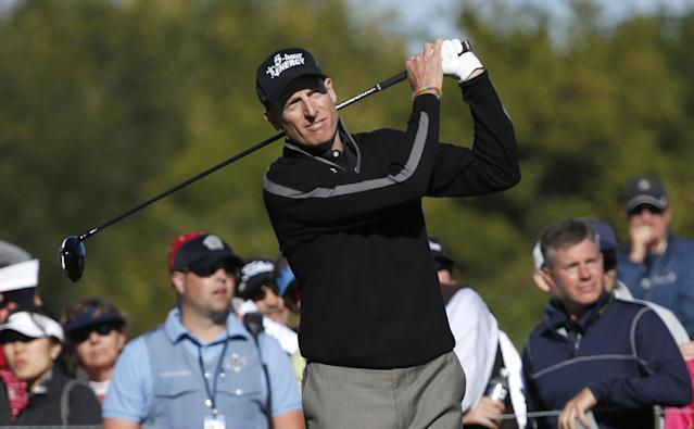 Jim Furyk watches his tee shot on the eighth hole during the second round of the BMW Championship golf tournament at Conway Farms Golf Club in Lake Forest, Ill., Friday, Sept. 13, 2013. Furyk posted a single round 59, tying the PGA Tour record. (AP Photo/Charles Rex Arbogast)