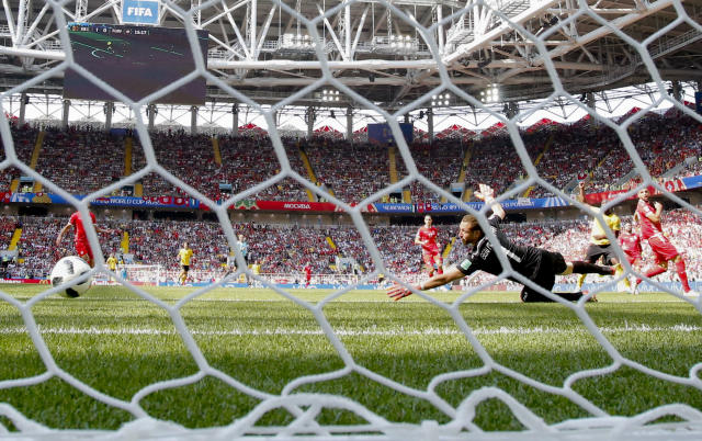 Belgium's Romelu Lukaku, 2nd right, scores his side' second goal during the group G match between Belgium and Tunisia at the 2018 soccer World Cup in the Spartak Stadium in Moscow, Russia, Friday, June 23, 2018. (AP Photo/Antonio Calanni)