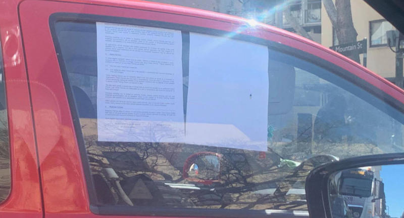 A Sydney driver was fined for sticking sheets of paper on her window to block out the sun.